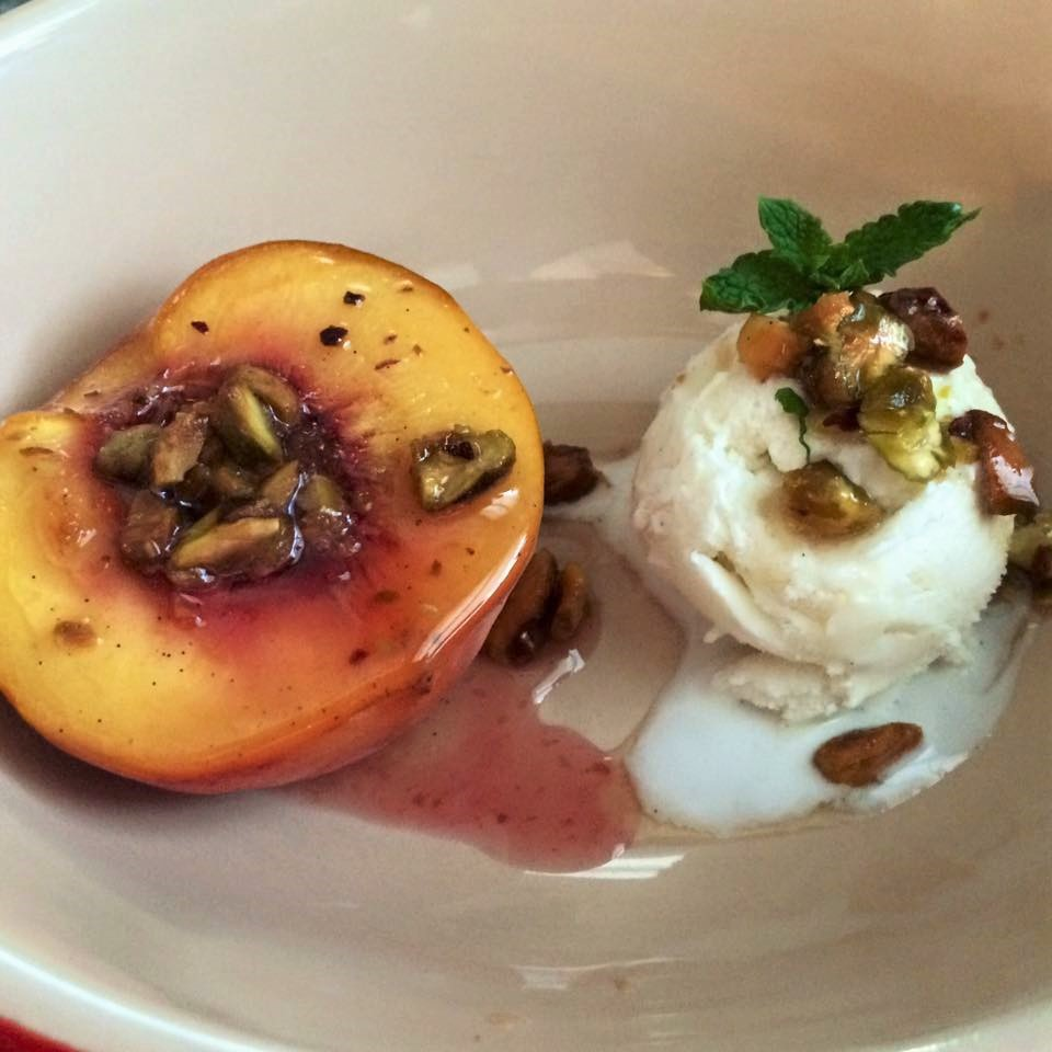 poached peaches with pistachio crumbs