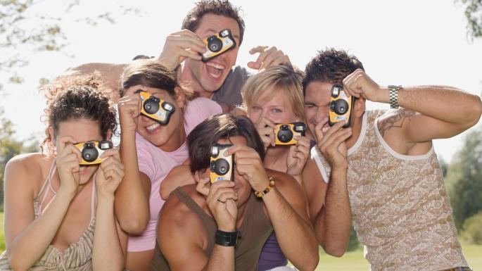 people with disposable cameras
